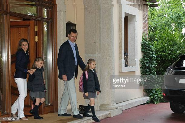 In this handout image supplied by Casa de SM el Rey Their Royal Highnesses Prince Felipe of Spain and Princess Letizia of Spain accompany their...