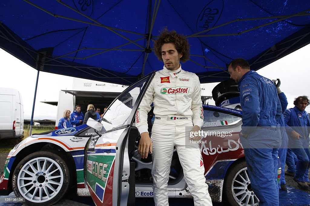 In this handout image supplied by Castrol, Moto GP rider Marco Simoncelli of Italy ptakes part in a one-off test with the Castrol sponsored Ford Abu Dhabi World Rally Team at their team base, on September 21, 2011 in Carlisle, England. The test was arranged by Castrol, who partner Simoncelli's San Carlo Honda Gresini Racing team.
