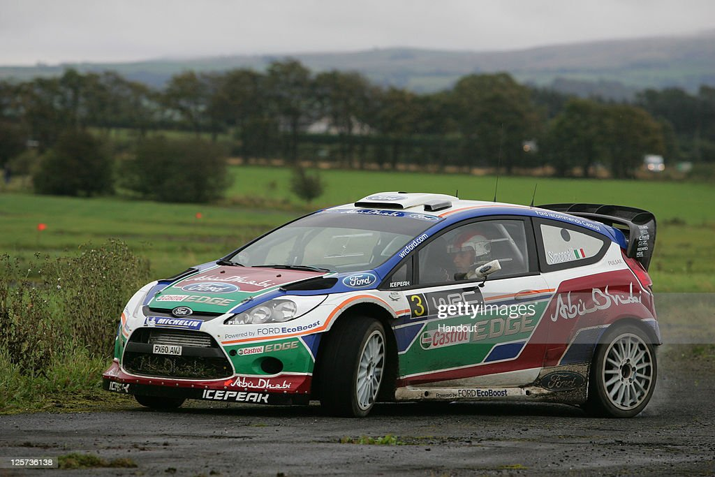 In this handout image supplied by Castrol, Moto GP rider Marco Simoncelli of Italy takes part in a one-off test with the Castrol sponsored Ford Abu Dhabi World Rally Team at their team base, on September 21, 2011 in Carlisle, England. The test was arranged by Castrol, who partner Simoncelli's San Carlo Honda Gresini Racing team.