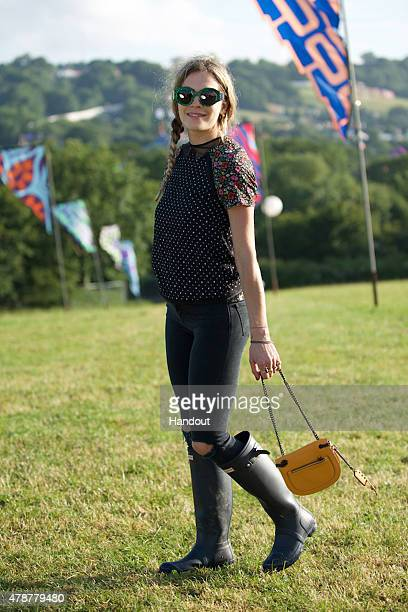 In this handout image supplied by Coach A festival attendee wearing Coach at the Glastonbury Festival at Worthy Farm Pilton on June 26 2015 in...