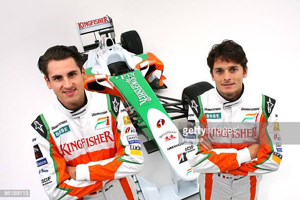 In this handout image supplied by Force India F1 Adrian Sutil of Germany and Force India and Giancarlo Fisichella of Italy and Force India attend the...