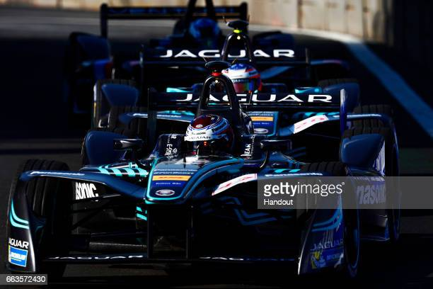 In this handout image supplied by Formula E Adam Carroll of Great Britain driving the Panasonic Jaguar Racing Jaguar ITYPE with team mate Mitch Evans...