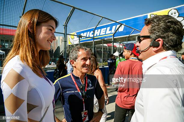 In this handout image supplied by Formula E Alain ProstAlejandro Agag CEO Formula E Holdings and a model during the Long Beach Formula E race at Long...