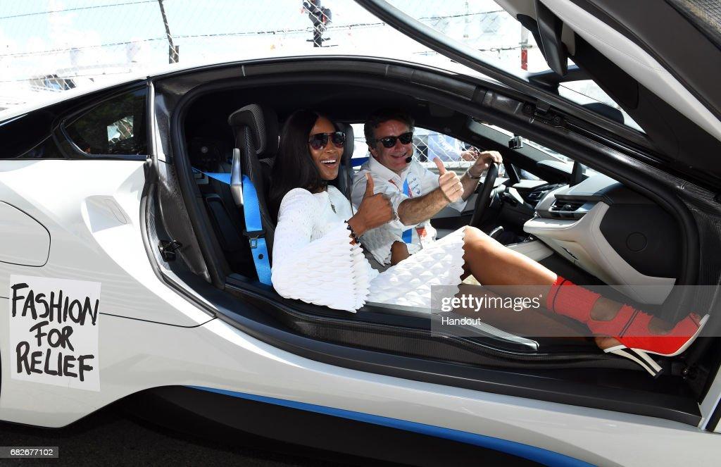 In this handout image supplied by Formula E, British model, Naomi Campbell, with Alejandro Agag, CEO, Formula E Holdings, during the FIA Formula E Championship Monaco ePrix on May 13, 2017 in Monte-Carlo, Monaco.