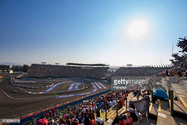 In this handout image supplied by Formula E fans watch the action during the Mexico City Formula E race at Puerto Autodromo Hermanos Rodriguez on...