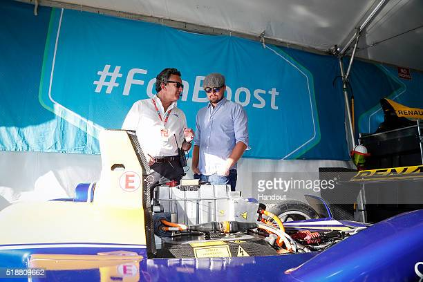 In this handout image supplied by Formula E Leonardo DiCaprio with Alejandro Agag CEO Formula E Holdings during the Long Beach Formula E race at Long...