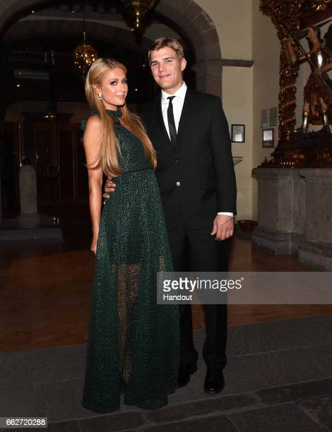 In this handout image supplied by Formula E Paris Hilton and Chris Zylka attend a dinner hosted by the FIA Formula E Championship Mexico City ePrix...