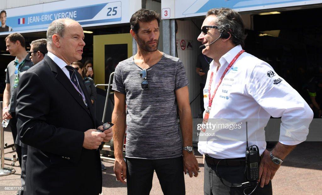 In this handout image supplied by Formula E, Prince Albert II of Monaco with ex-F1 driver, Mark Webber, and Alejandro Agag, CEO, Formula E Holdings during the FIA Formula E Championship Monaco ePrix on May 13, 2017 in Monte-Carlo, Monaco.