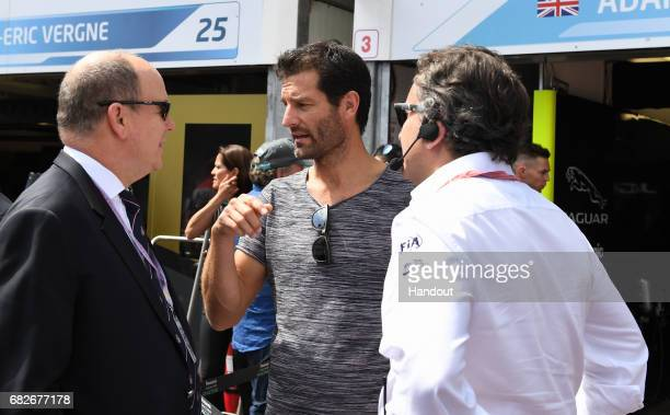 In this handout image supplied by Formula E, Prince Albert II of Monaco with ex-F1 driver, Mark Webber, and Alejandro Agag, CEO, Formula E Holdings,...