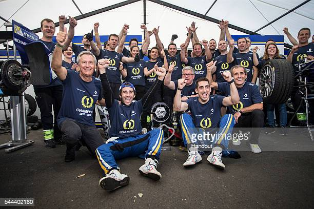 In this handout image supplied by Formula E Sebastien Buemi Renault eDams ZE15 and Nicolas Prost Renault eDams ZE15 celebrate in the garage during...