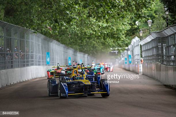 In this handout image supplied by Formula E Sebastien Buemi Renault eDams ZE15 leads at the start during the London Formula E race on JULY 3 2016 in...