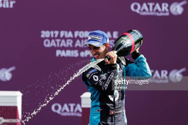 In this handout image supplied by Formula E Sebastien Buemi Renault eDams SparkRenault Renault ZE 16 sprays the champagne on the podium after winning...