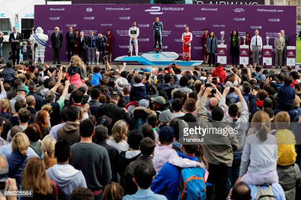 In this handout image supplied by Formula E Winner Sebastien Buemi Renault eDams SparkRenault Renault ZE 16 celebrates on the podium with Jose Maria...