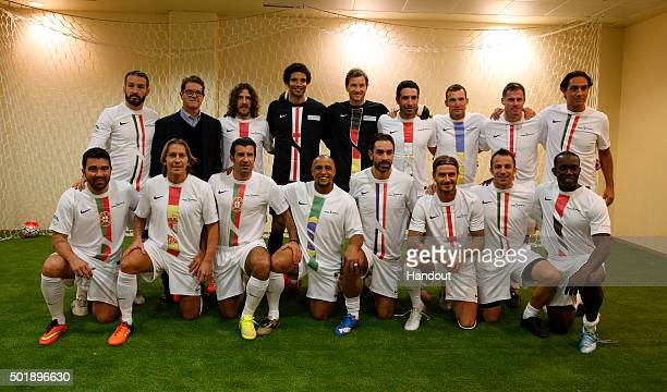 In this handout image supplied by Francisco Paraiso Luis Figo and David Beckham and the World Stars XI team pose prior to the Kuwait Champions...