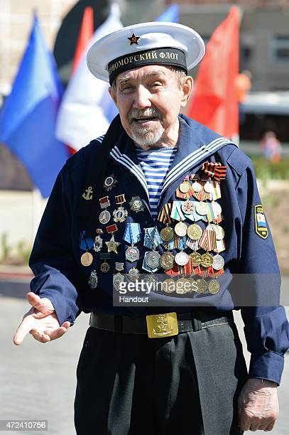 In this handout image supplied by Host photo agency / RIA Novosti Alexander Kovalev attends a meeting of veterans graduates of the Solovki Young...