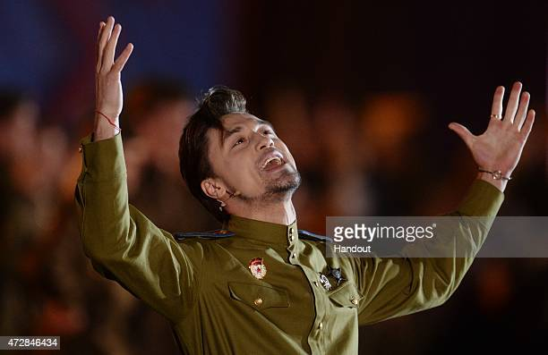 In this handout image supplied by Host photo agency / RIA Novosti Singer Dima Bilan performs during the gala concert held in Red Square to mark the...