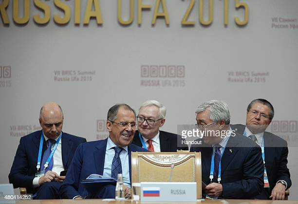 In this handout image supplied by Host Photo Agency / RIA Novosti, From left: Anton Siluanov, Minister of Finance of the Russian Federation; Sergei...