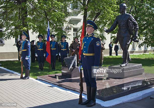 In this handout image supplied by Host photo agency / RIA Novosti Guard of Honor at a monument to a frontline postman during its unveiling ceremony...