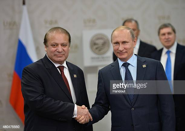 In this handout image supplied by Host Photo Agency / RIA Novosti left in the foreground President of the Russian Federation Vladimir Putin and Nawaz...