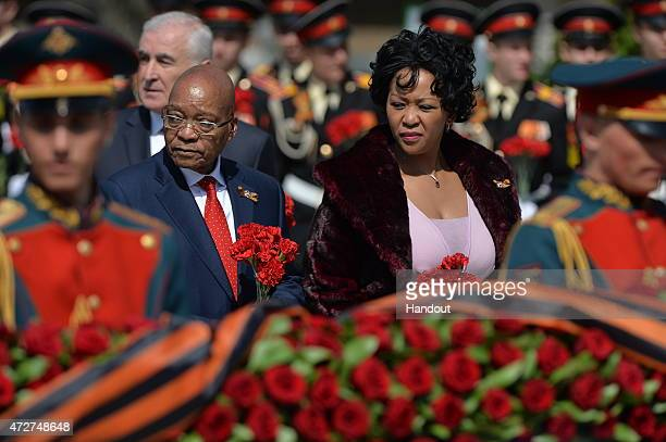 In this handout image supplied by Host photo agency / RIA Novosti President of South Africa Jacob Zuma and his wife at the flowerlaying ceremony at...