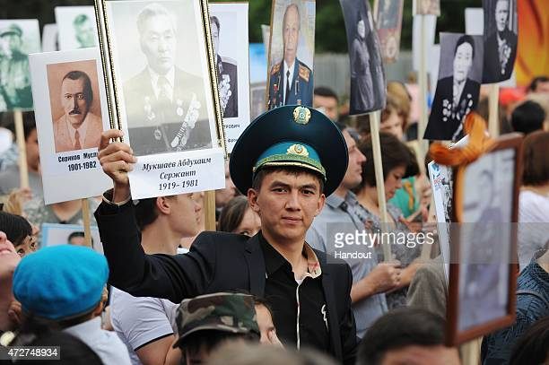 In this handout image supplied by Host photo agency / RIA Novosti participants of the Immortal Regiment organization march on the 70th anniversary of...
