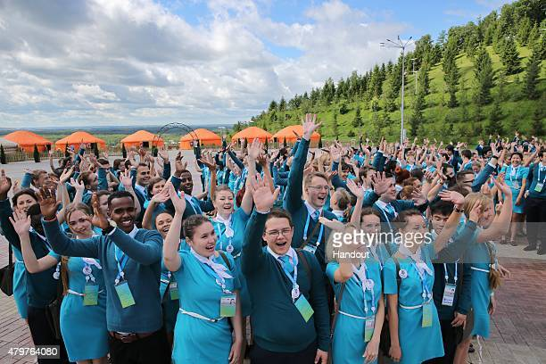 In this handout image supplied by Host Photo Agency / RIA Novosti volunteers of the SCO and BRICS summits on July 06 2015 in Ufa Russia