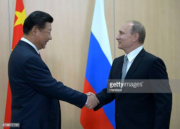 In this handout image supplied by Host Photo Agency / RIA Novosti President of the Russian Federation Vladimir Putin meets with President of the...