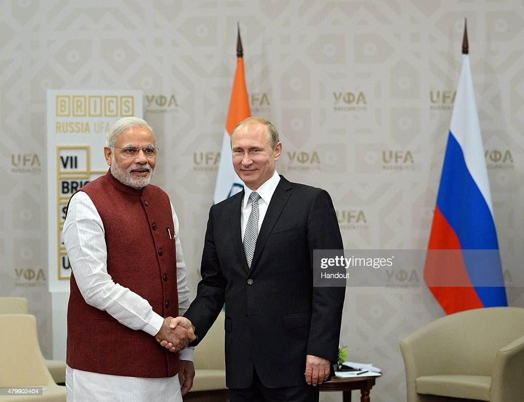 In this handout image supplied by Host Photo Agency / RIA Novosti, President of the Russian Federation Vladimir Putin (R) meets Prime Minister of the Republic of India Narendra Modi in Ufa during the BRICS/SCO Summits - Russia 2015 on July 08, 2015 in Ufa, Bashkortostan, Russia.