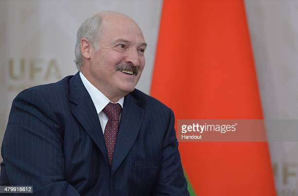In this handout image supplied by Host Photo Agency / RIA Novosti, President of the Republic of Belarus Alexander Lukashenko meets with President of...