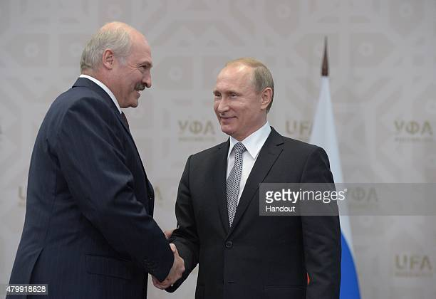In this handout image supplied by Host Photo Agency / RIA Novosti, President of the Russian Federation Vladimir Putin meets President of the Republic...