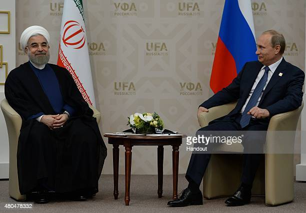 In this handout image supplied by Host Photo Agency / RIA Novosti, President of the Russian Federation Vladimir Putin and President of the Islamic...