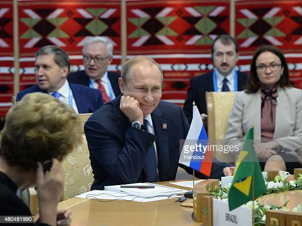 In this handout image supplied by Host Photo Agency / RIA Novosti President of the Russian Federation Vladimir Putin at a BRICS leaders limited...