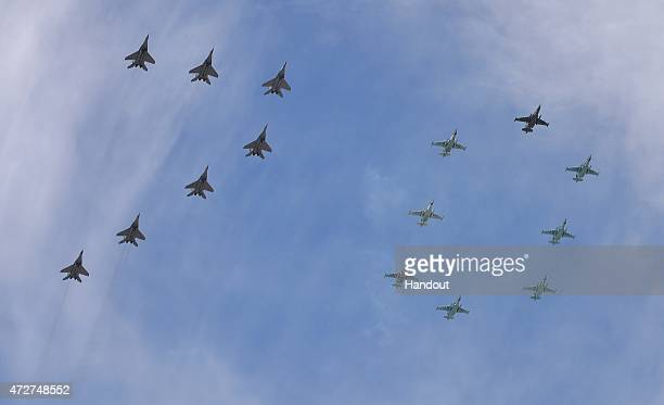 In this handout image supplied by Host photo agency / RIA Novosti MikoyanGurevich MiG29 Fulcrum fighters and Sukhoi Su25 Frogfoot groundattack planes...