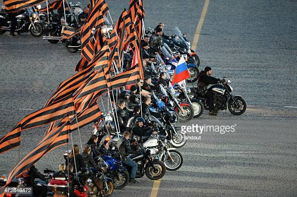 In this handout image supplied by Host photo agency / RIA Novosti Alexander 'The Surgeon' Zaldostanov right leader of the Night Wolves bikers' club...