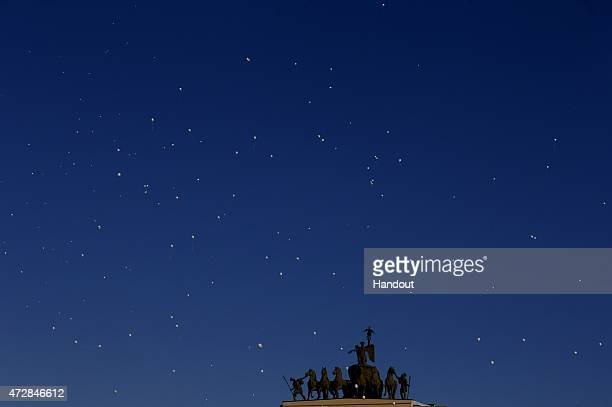 In this handout image supplied by Host photo agency / RIA Novosti White balloons of peace in the sky over Palace Square during the celebrations of...