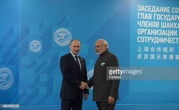 In this handout image supplied by Host Photo Agency/RIA Novosti President of the Russian Federation Vladimir Putin left and Narendra Modi Prime...