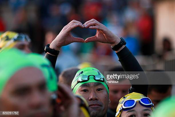 In this handout image supplied by Ironman An athlete reacts during the Standard Bank IRONMAN African Championship at Nelson Mandela Bay Port...