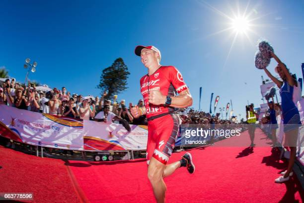 In this handout image supplied by Ironman, Ben Hoffman winning the Ironman Triathlon at Nelson Mandela Bay, Port Elizabeth on April 2nd, 2017 in Port...