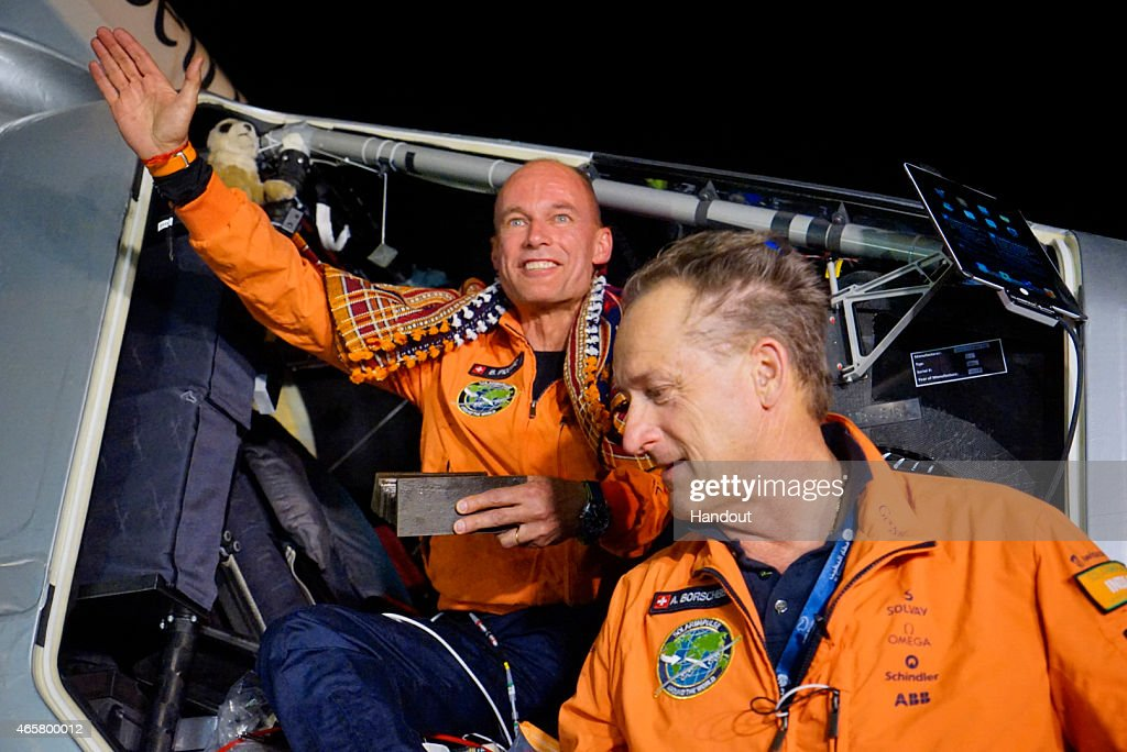 In this handout image supplied by Jean Revillard, Bertrant Piccard (L) is shown after landing the Solar Impulse 2, a solar-powered airplane on the second leg of an around-the-world journeyMarch 10, 2015 in Ahmedabad, India. With this 15:20-hour flight, Piccard set a new world record for solar distance flight with 1486 kilometers. The trip continues on March 16. The 35,000km journey is expected to last five months and is piloted by Andre Borschberg (R) and Bertrand Piccard of Switzerland. The Solar Impulse 2 is equipped with 17,000 solar cells, has a wingspan of 72 metres, and yet weighs just over 2 tonnes.
