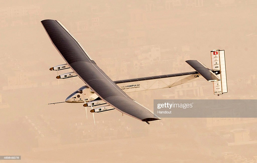 In this handout image supplied by Jean Revillard, Solar Impulse 2, a solar-powered airplane, takes flight as it begins its historic round-the-world journey from Al Bateen Airport, on March 09, 2015 from Abu Dhabi, UAE. The 35,000km journey is expected to last five months and is piloted by Andre Borschberg and Bertrand Piccard of Switzerland. The Solar Impulse 2 is equipped with 17,000 solar cells, has a wingspan of 72 metres, and yet weighs just over 2 tonnes.