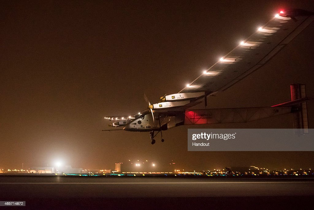 In this handout image supplied by Jean Revillard, Solar Impulse 2, a solar-powered airplane, lands with pilot Andre Boschberg at the helm to finish the first day of an historic round-the-world journey that began in Abu Dhabi, UAE, on March 09, 2015 in Muscat, Oman. The 35,000km journey is expected to last five months and is piloted by Andre Borschberg and Bertrand Piccard of Switzerland. The Solar Impulse 2 is equipped with 17,000 solar cells, has a wingspan of 72 metres, and yet weighs just over 2 tonnes.