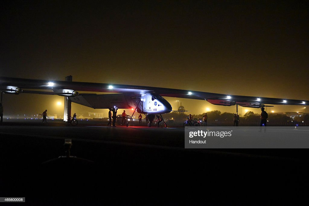 In this handout image supplied by Jean Revillard, Solar Impulse 2, a solar-powered airplane piloted by Bertrant Piccard, is shown after landing March 10, 2015 in Ahmedabad, India. With this 15:20-hour flight, Piccard set a new world record for solar distance flight with 1486 kilometers. The trip continues on March 16. The 35,000km journey is expected to last five months and is piloted by Andre Borschberg and Bertrand Piccard of Switzerland. The Solar Impulse 2 is equipped with 17,000 solar cells, has a wingspan of 72 metres, and yet weighs just over 2 tonnes.