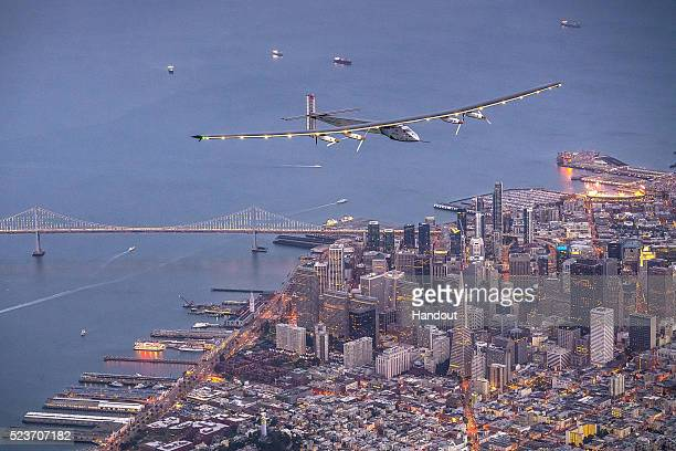 In this handout image supplied by Jean Revillard, Solar powered plane 'Solar Impulse 2', piloted by Swiss adventurer Bertrand Piccard, flys over the...