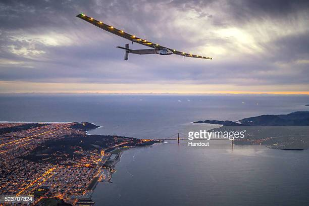 In this handout image supplied by Jean Revillard Solar powered plane 'Solar Impulse 2' piloted by Swiss adventurer Bertrand Piccard flys over the...