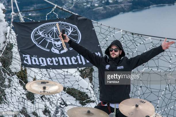 In this handout image supplied by Jägermeister Pat Lundy of London band Modestep performs a thrilling Jägermeister Ice Cold Gig suspended between two...