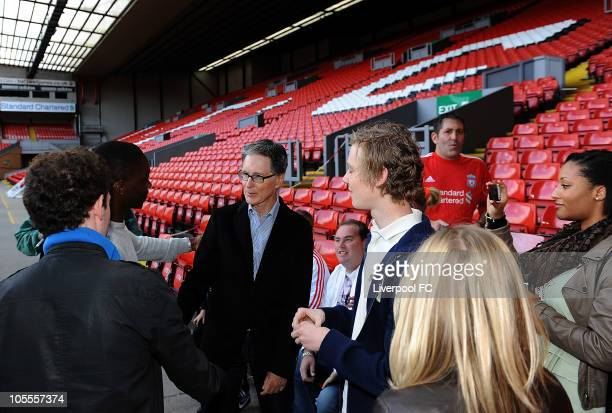 In this handout image supplied by Liverpool Football Club, John W Henry of NESV meets fans on The Kop at Anfield on October 16, 2010 in Liverpool,...