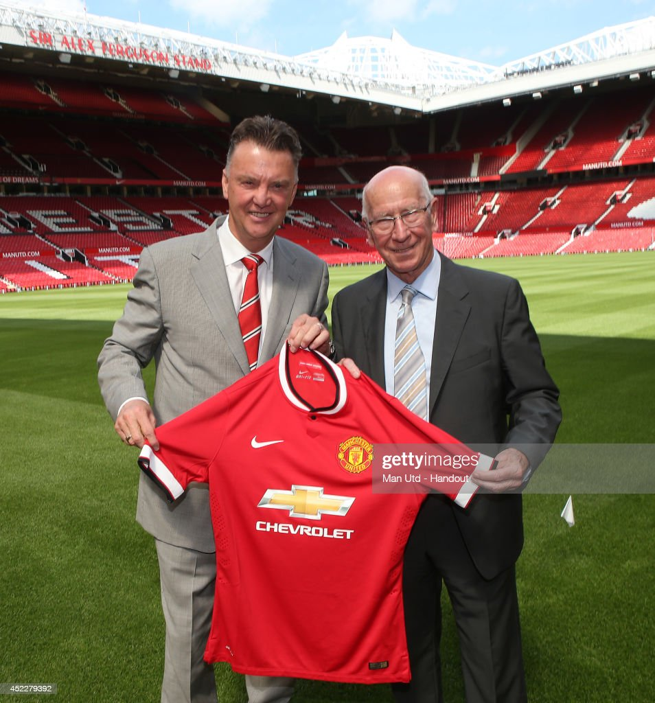 In this handout image supplied by Manchester United FC, new manager Louis van Gaal (L) of Manchester United poses with club legend Sir Bobby Charlton after a press conference to announce his arrival at Old Trafford on July 17, 2014 in Manchester, England.