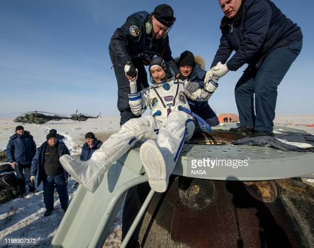 In this handout image supplied by NASA, ESA astronaut Luca Parmitano is helped out of the Soyuz MS-13 spacecraft just minutes after he, NASA...