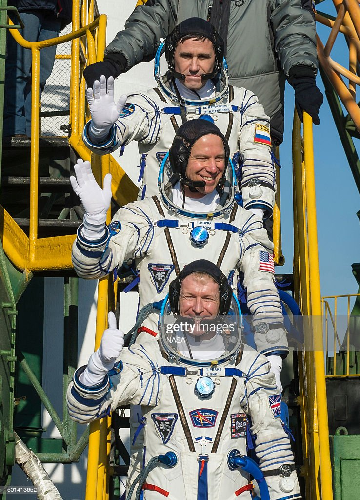 In this handout image supplied by NASA, Expedition 46 Soyuz Commander Yuri Malenchenko of the Russian Federal Space Agency (Roscosmos), top, Flight Engineer Tim Kopra of NASA, center, and Flight Engineer Tim Peake of ESA (European Space Agency), bottom, wave farewell prior to boarding the Soyuz TMA-19M rocket for launch on December 15, 2015 in Baikonur, Kazakhstan. Soyuz TMA-19M is scheduled to launch on December 15 carrying crew members Soyuz Commander Yuri Malenchenko of the Russian Federal Space Agency (Roscosmos), Flight Engineer Tim Kopra of NASA, and Flight Engineer Tim Peake of ESA (European Space Agency) to the International Space Station for a six-month mission, as part of Expedition 46.