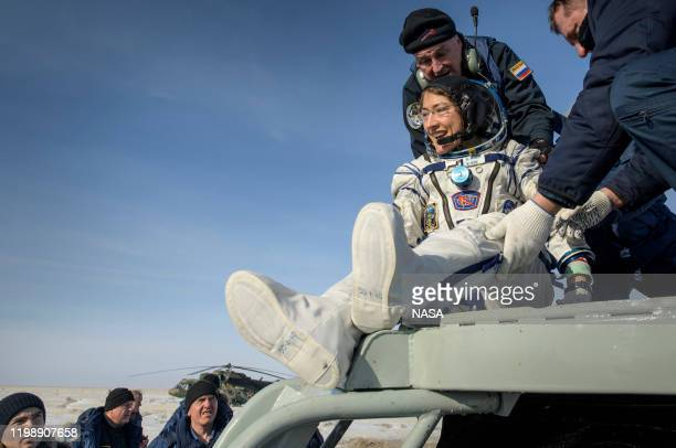 In this handout image supplied by NASA NASA astronaut Christina Koch is helped out of the Soyuz MS13 spacecraft just minutes after she Roscosmos...